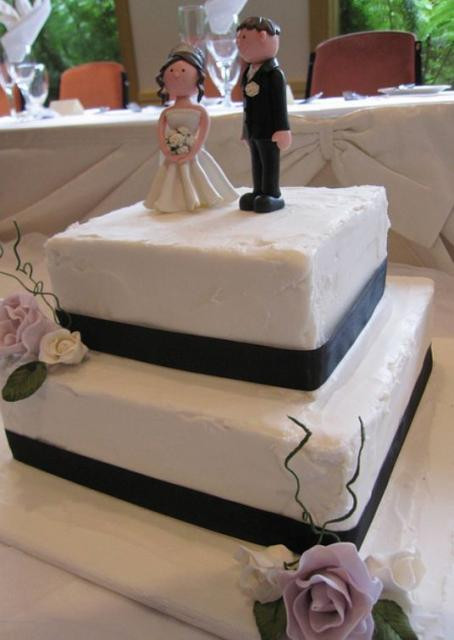 2 Tier Square Wedding Cakes  Two tier square white wedding cake with black band and