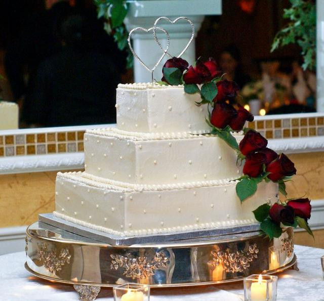 3 Tier Square Wedding Cakes  Three tier square ivory wedding cake with red roses and
