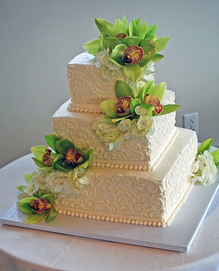 3 Tiered Square Wedding Cakes  Three tier ivory square wedding cake with fresh flowers