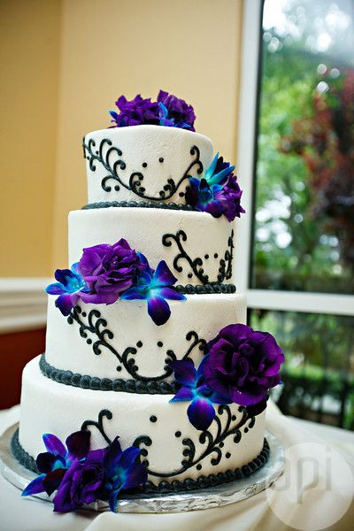 Blue And Purple Wedding Cakes  White Cake With Purple Flowers There is a lot I like