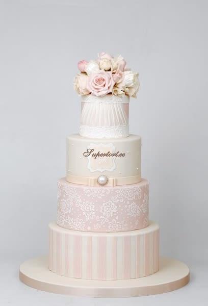 Blush Pink Wedding Cakes  Ivory and blush pink wedding cake cake by Olga Danilova
