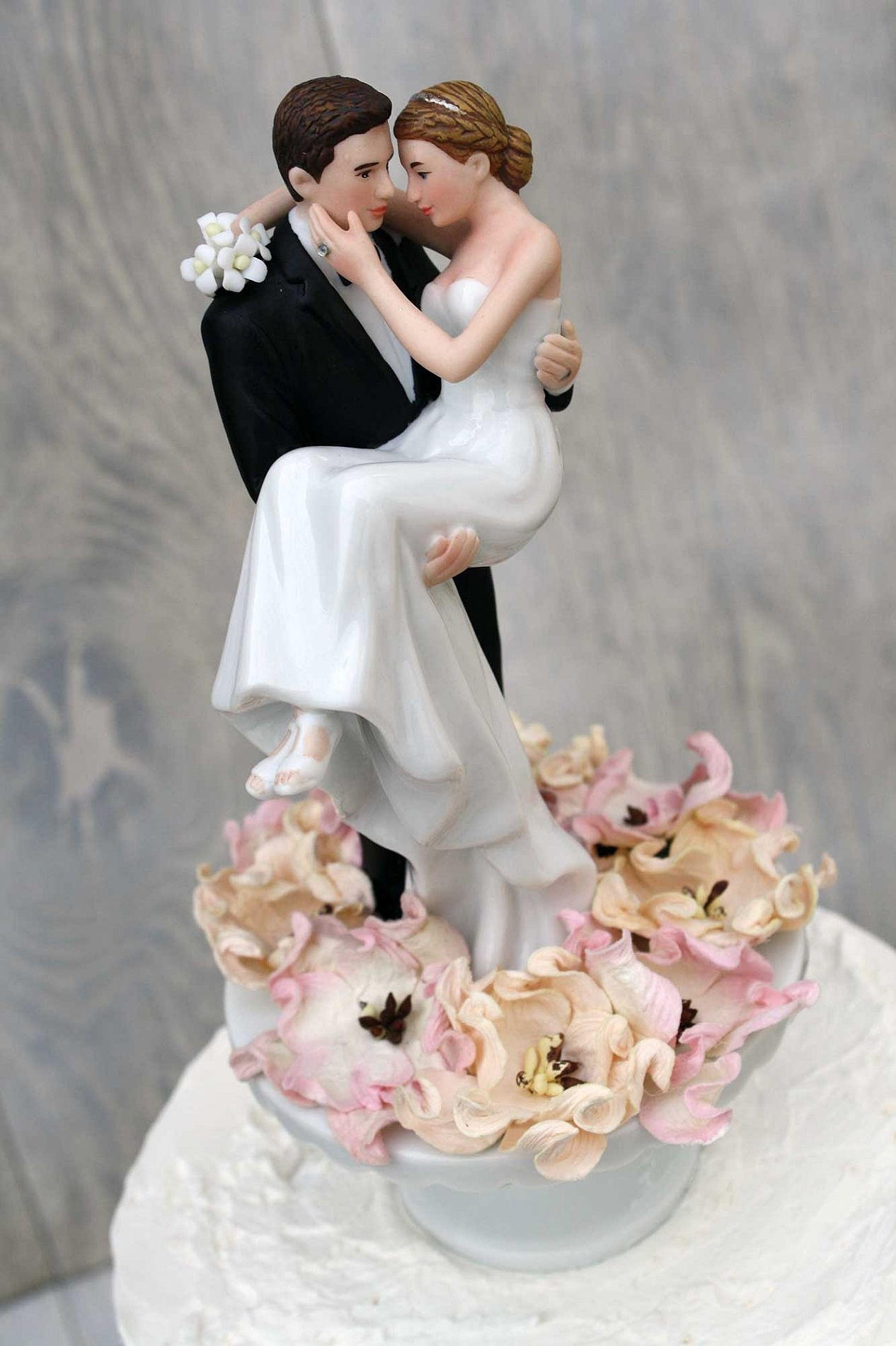 Bride And Groom Toppers For Wedding Cakes  Bed of Roses Groom Holding the Bride Wedding Cake Topper