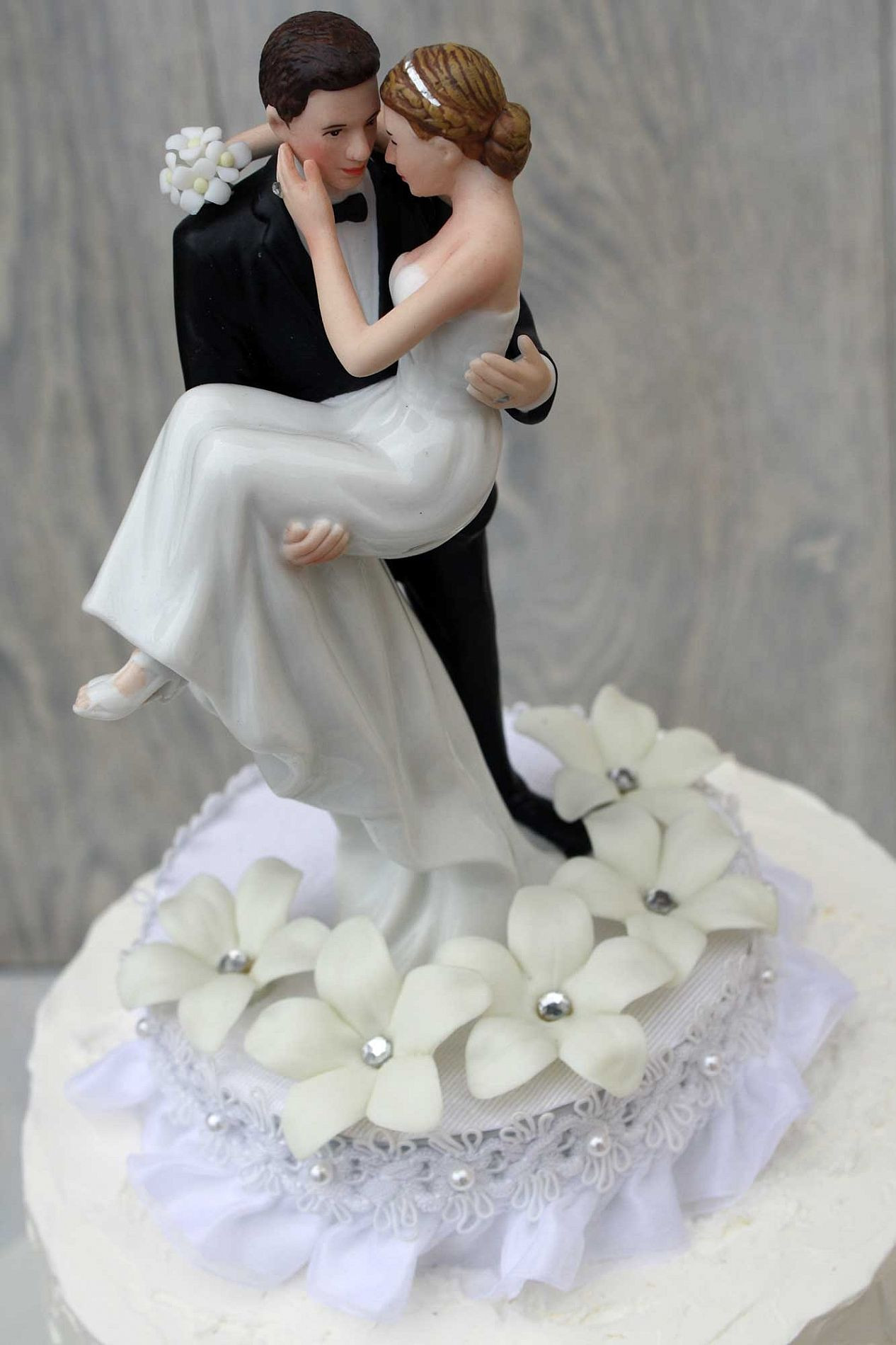 Bride And Groom Toppers For Wedding Cakes  Stephanotis Groom Holding the Bride Wedding Cake Topper
