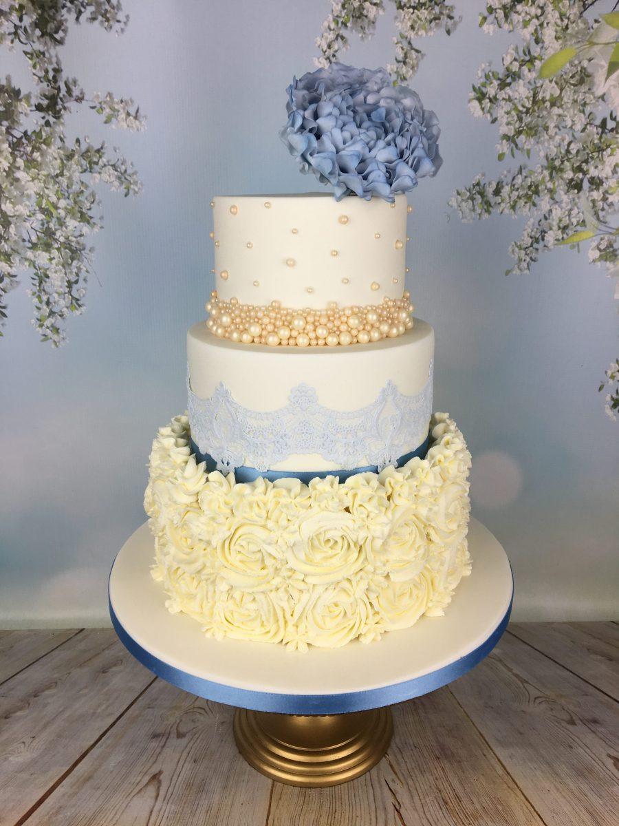 Buttercream Wedding Cakes  Blue and cream buttercream rosette wedding cake Mel s