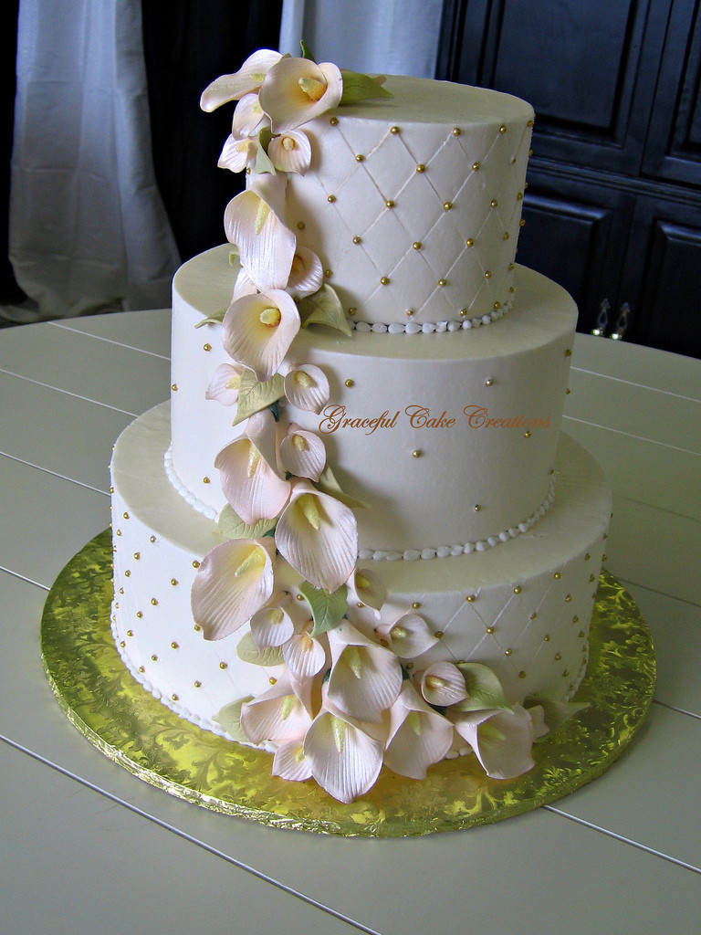 Calla Lilies Wedding Cakes  Elegant Ivory and Gold Wedding Cake with Champagne Colored