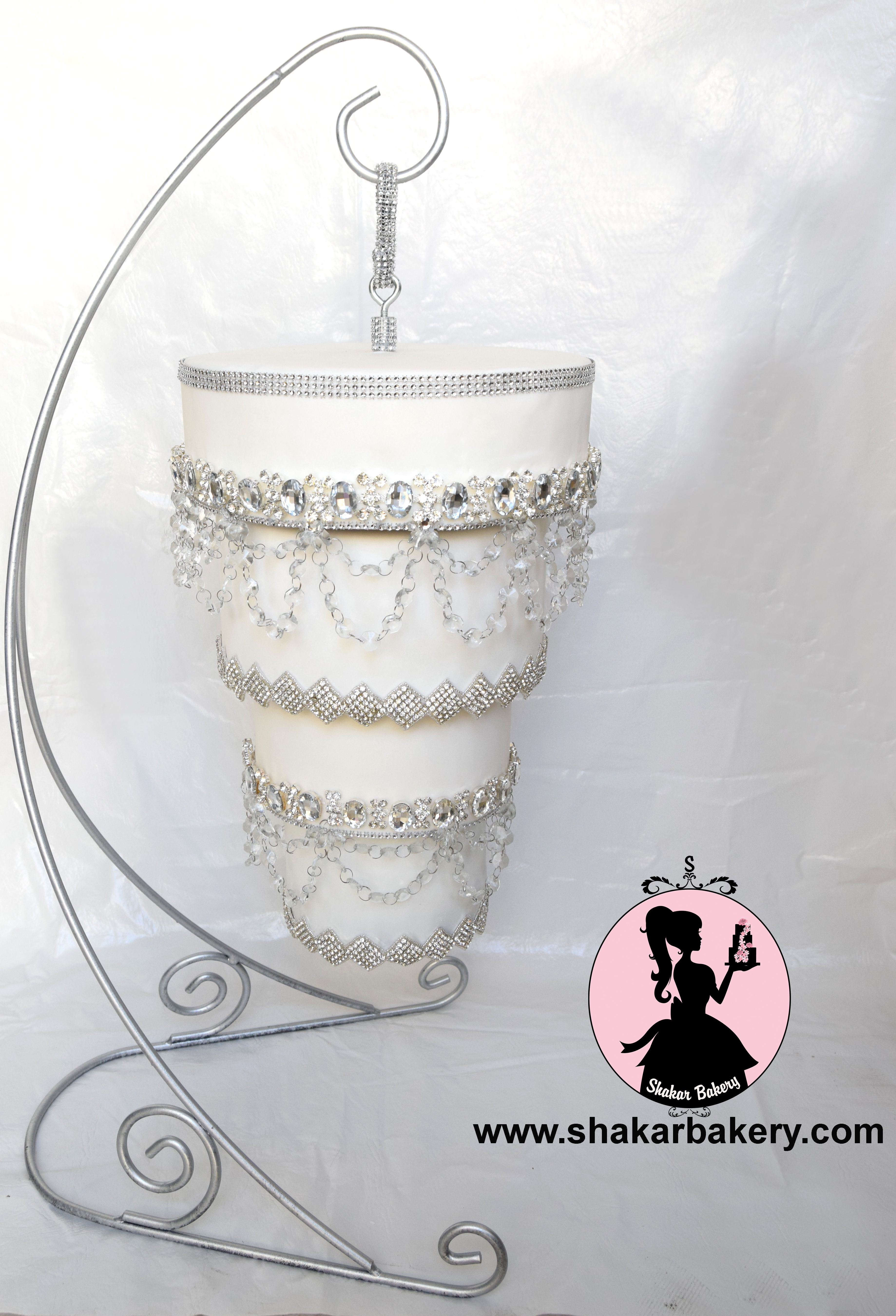 Chandelier Wedding Cakes  Four tier crystal chandelier wedding cake designed for a
