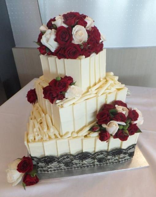 Chocolate And White Wedding Cakes  Three tier white chocolate wedding cake with red and white