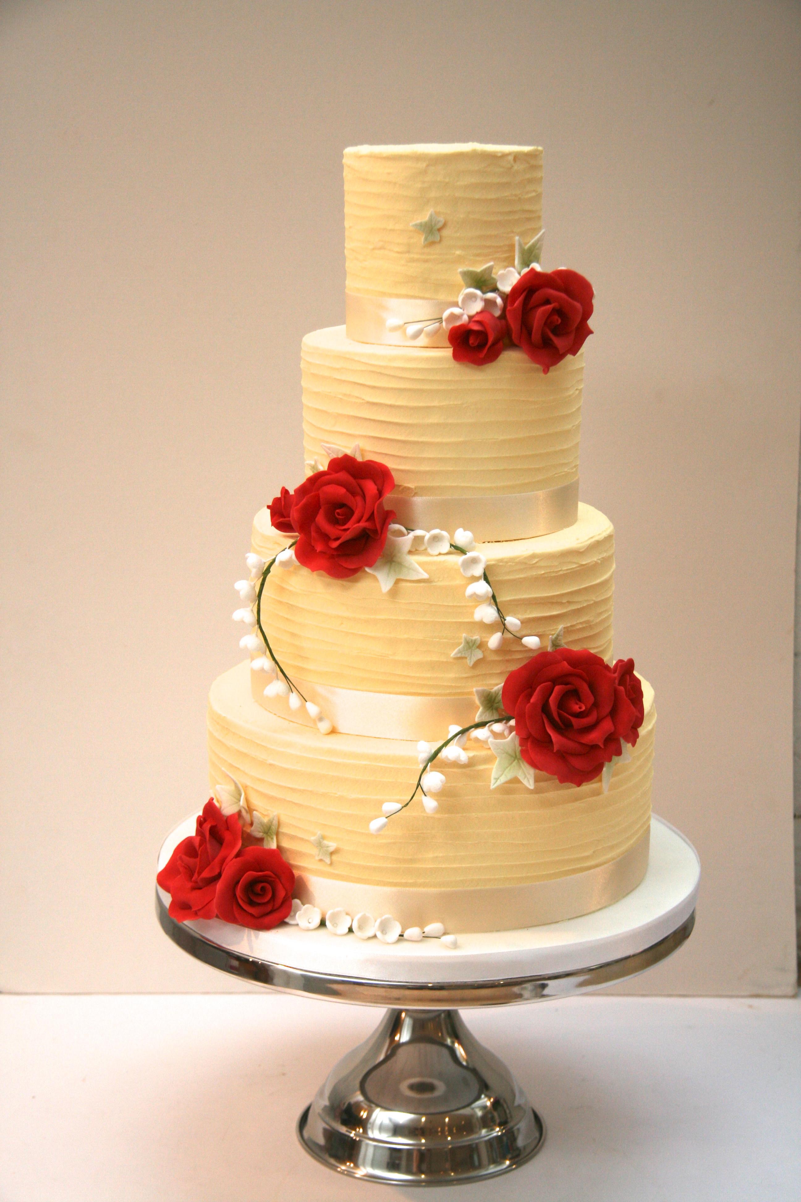Chocolate Ganache Wedding Cakes  White Chocolate Ganache Wedding Cake with Red Roses and