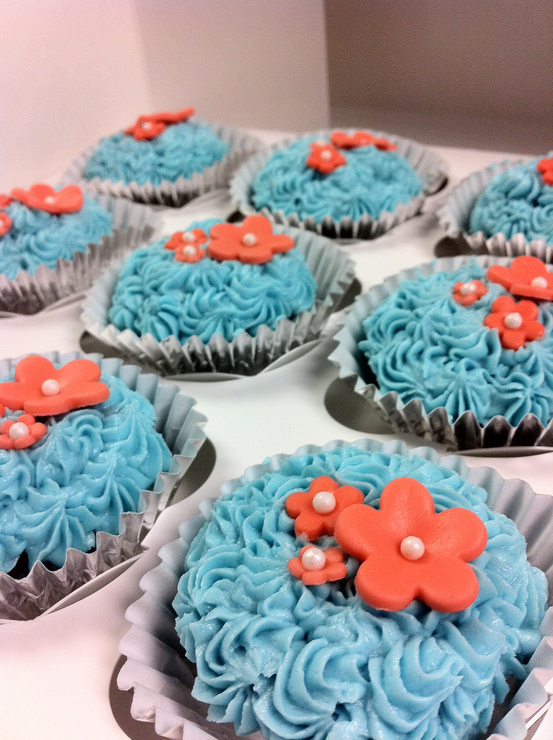 Coral And Teal Wedding Cakes  Teal coral bridal shower flower cupcakes