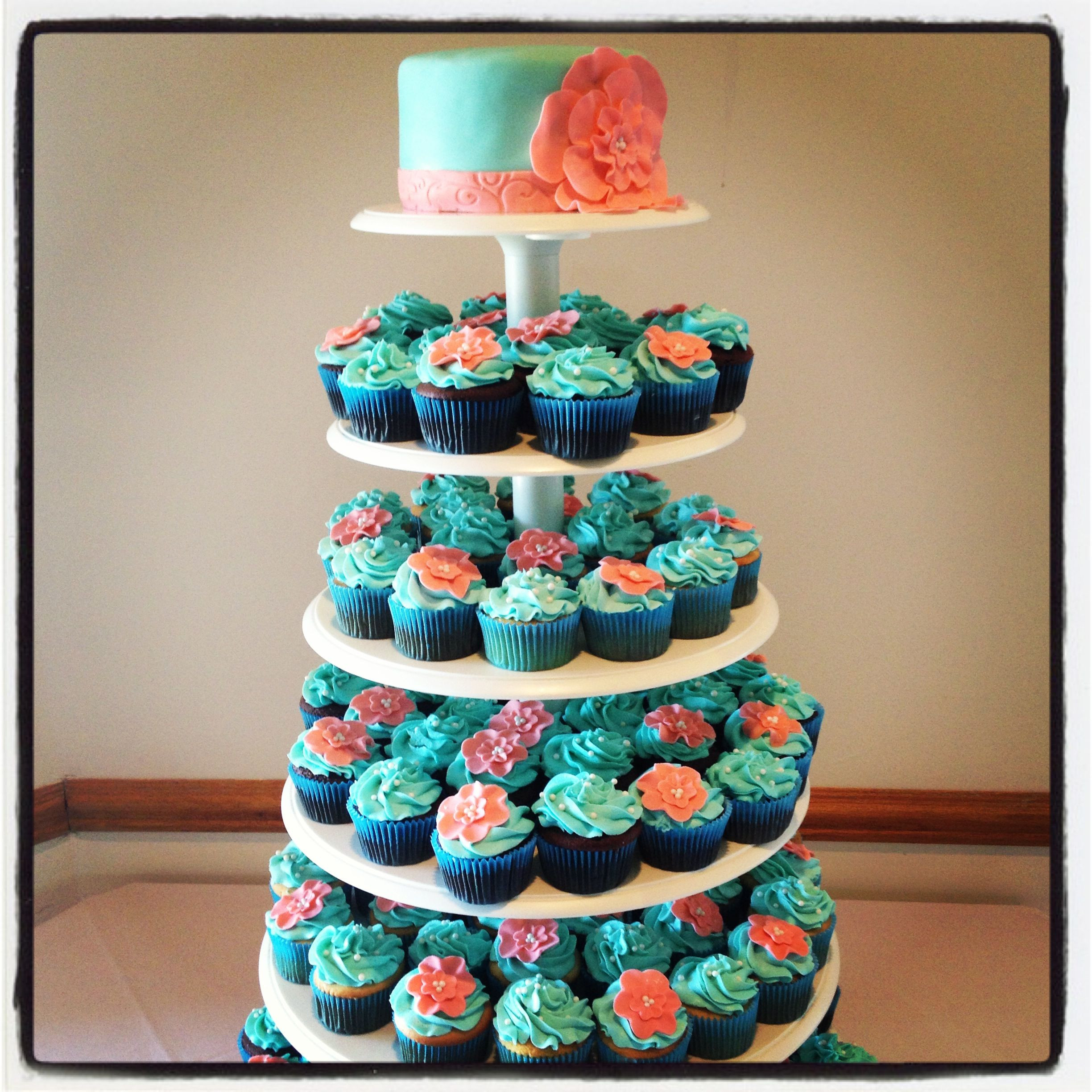 Coral And Teal Wedding Cakes  Teal & Coral Wedding Cupcake Tower love the idea of