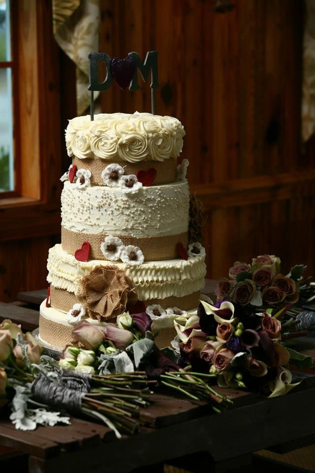 Country Style Wedding Cakes  4 tier country style wedding cake with burlap ribbon and
