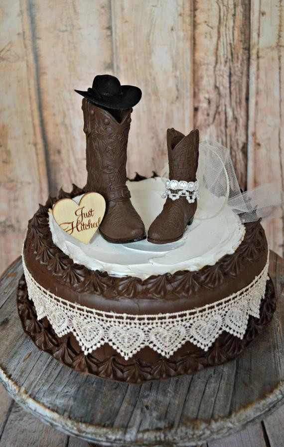 Cowboy Wedding Cakes  cowgirl Just hitched western wedding cowboy boot cake topper