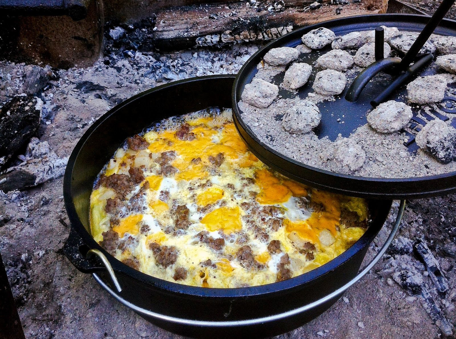 Dutch Oven Camping Recipes Breakfast  Mountain Man Breakfast Casserole cooked over hot coals in