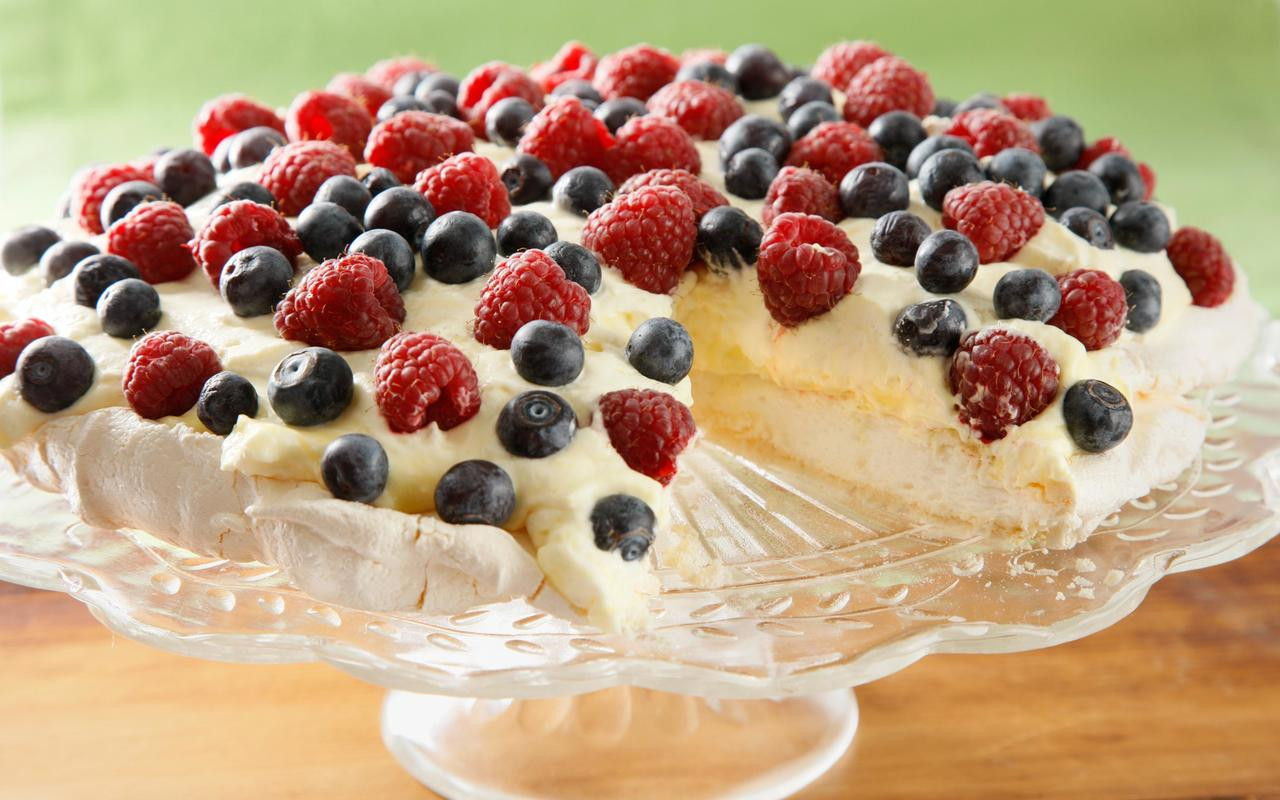 Easter Desserts Recipes  Pavlova with Lemon Curd and Fresh Berries Recipe Chowhound