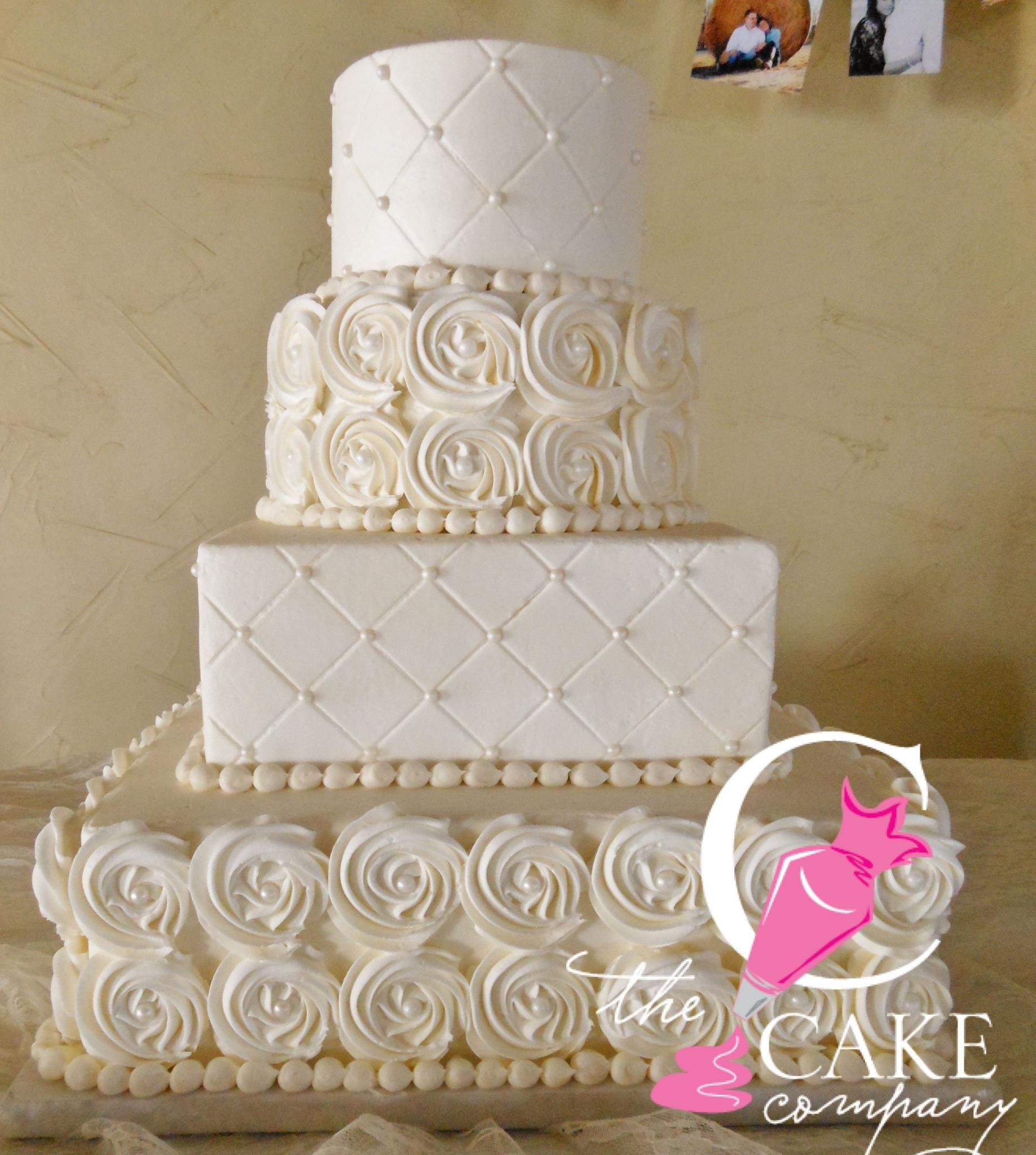 Edible Pearls For Wedding Cakes  4 tier light ivory cake with rosettes quilt press and