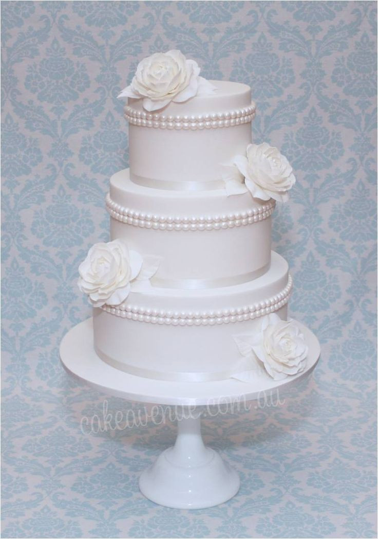 Edible Pearls For Wedding Cakes  White wedding cake with edible pearls and sugar Camellias