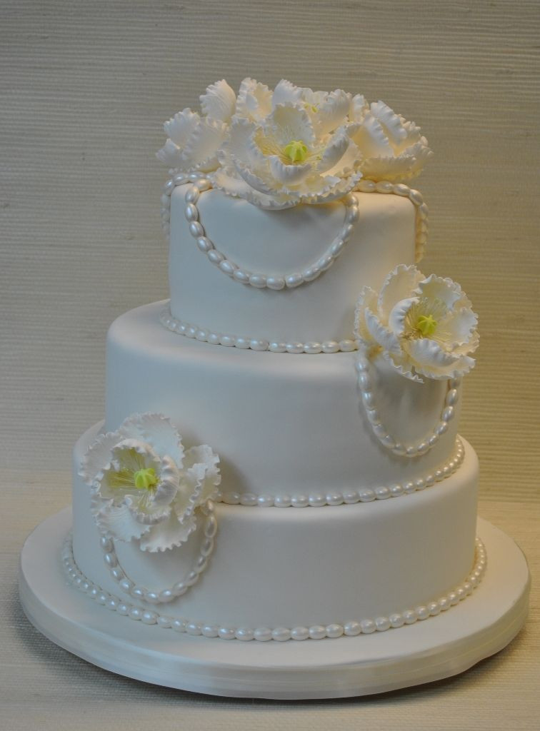 Edible Pearls For Wedding Cakes  White fondant wedding cake with edible pearls and white