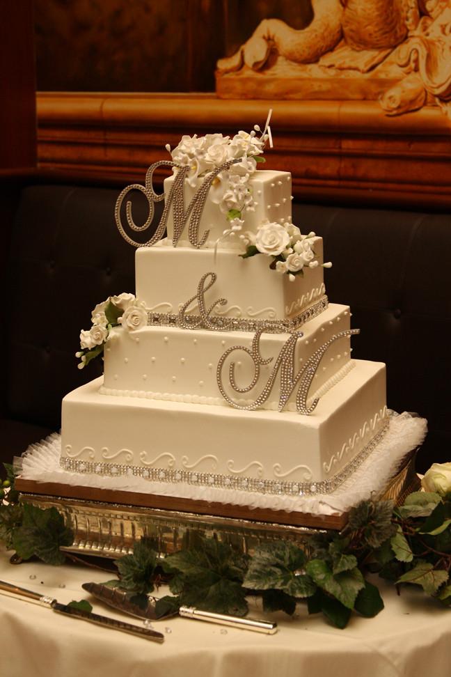 Elegant Buttercream Wedding Cakes  Crystal Monogram Buttercream Wedding Cake • Palermo s