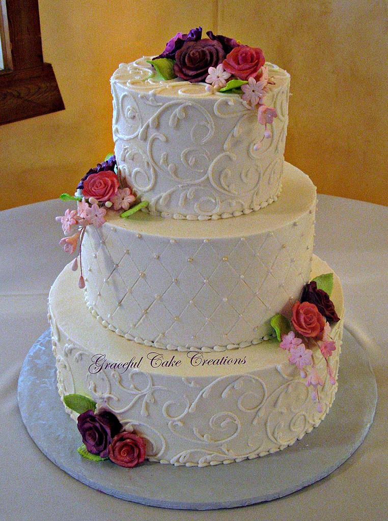 Elegant Buttercream Wedding Cakes  Elegant Ivory Buttercream Wedding Cake with Purple and Pin