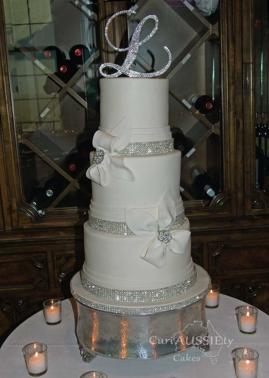 Elegant Wedding Cakes With Bling  Elegant White Bow And Bling Wedding Cake CakeCentral