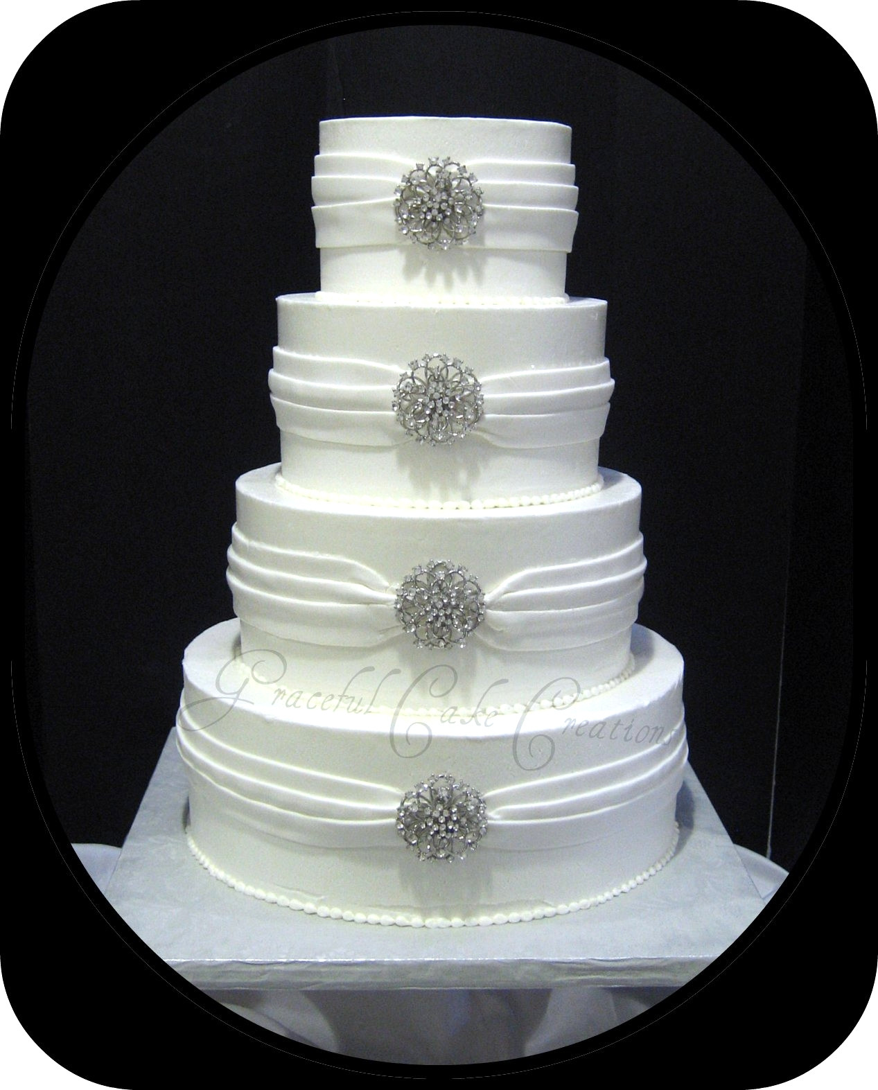 Elegant White Wedding Cakes  Elegant White Wedding Cake with Silver Jewelry
