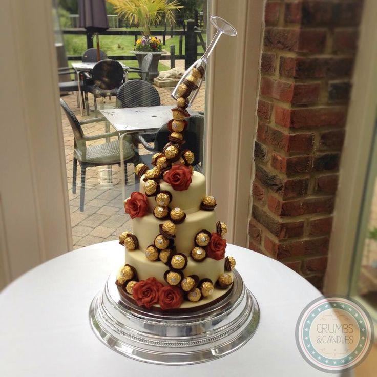 Ferrero Rocher Wedding Cakes  Ferrero Rocher wedding cake with hand made sugar roses