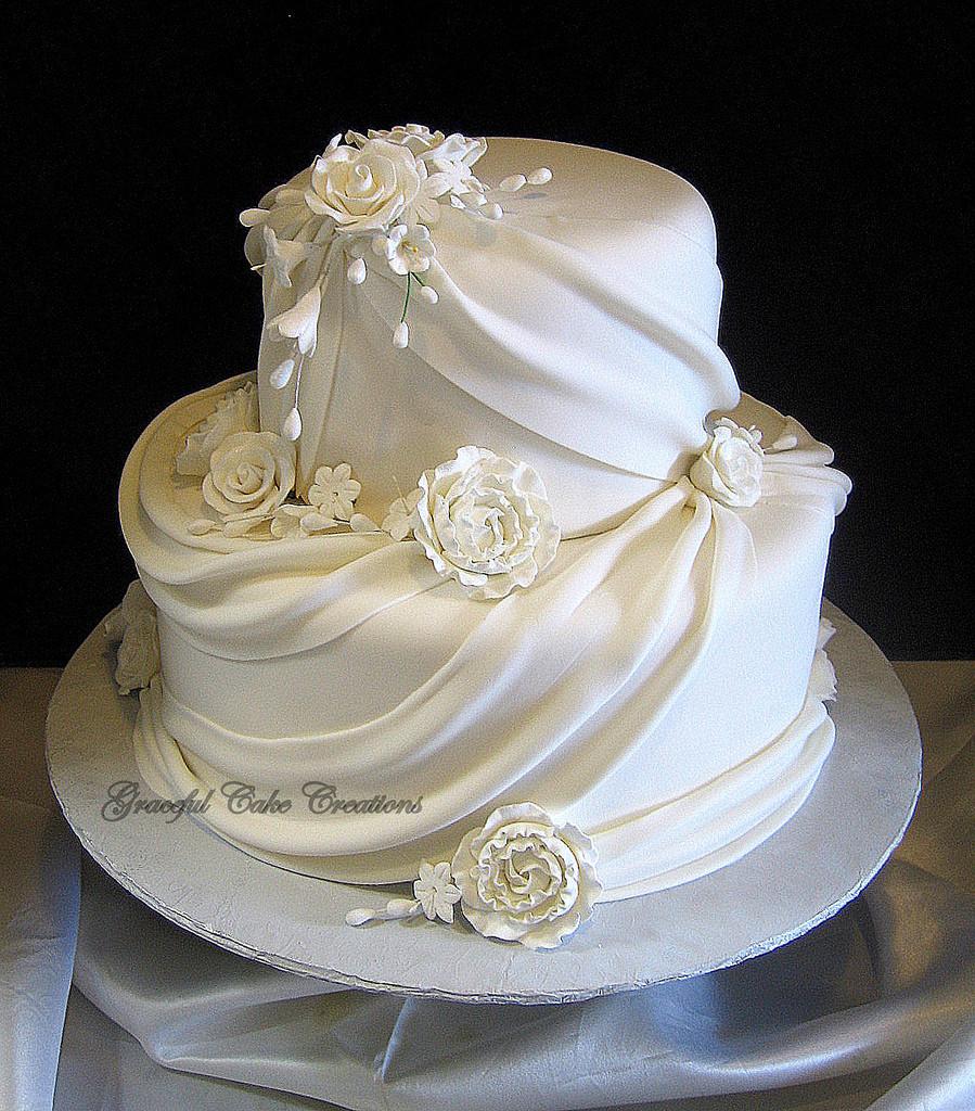 Fondant Wedding Cakes  Elegant White Fondant Wedding Cake with Sugar Flowers and