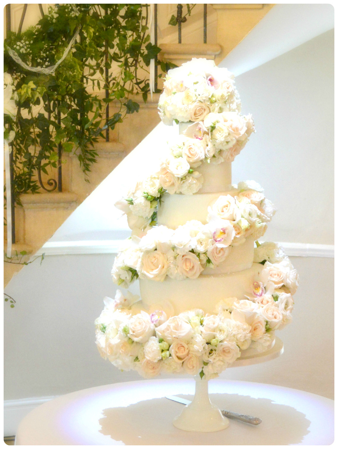 Fresh Flowers On Wedding Cakes  Cascade Spiral ivory white fresh flowers Roses Orchid
