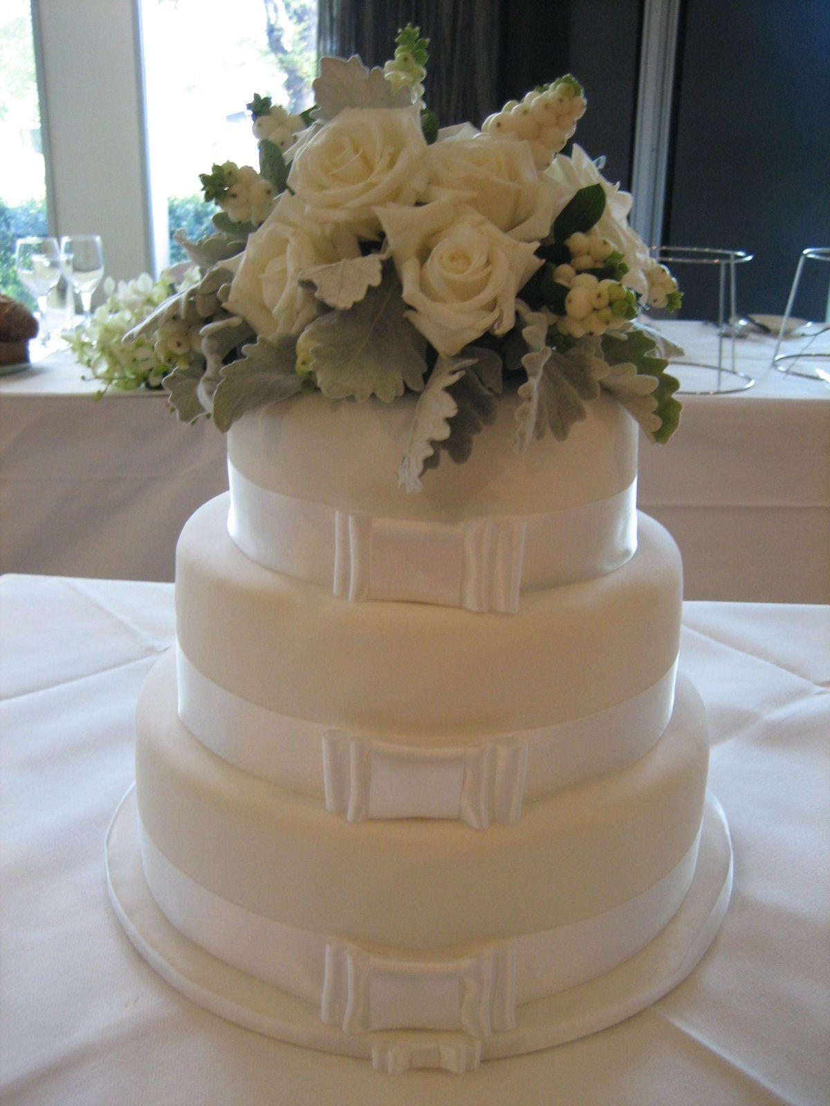 Fresh Flowers On Wedding Cakes  Fresh flower wedding cake topper using white roses dusty