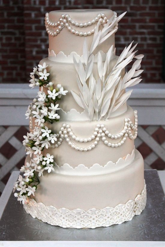 Gatsby Wedding Cakes  Four Tier Satin Wedding Cake Decorated In Style