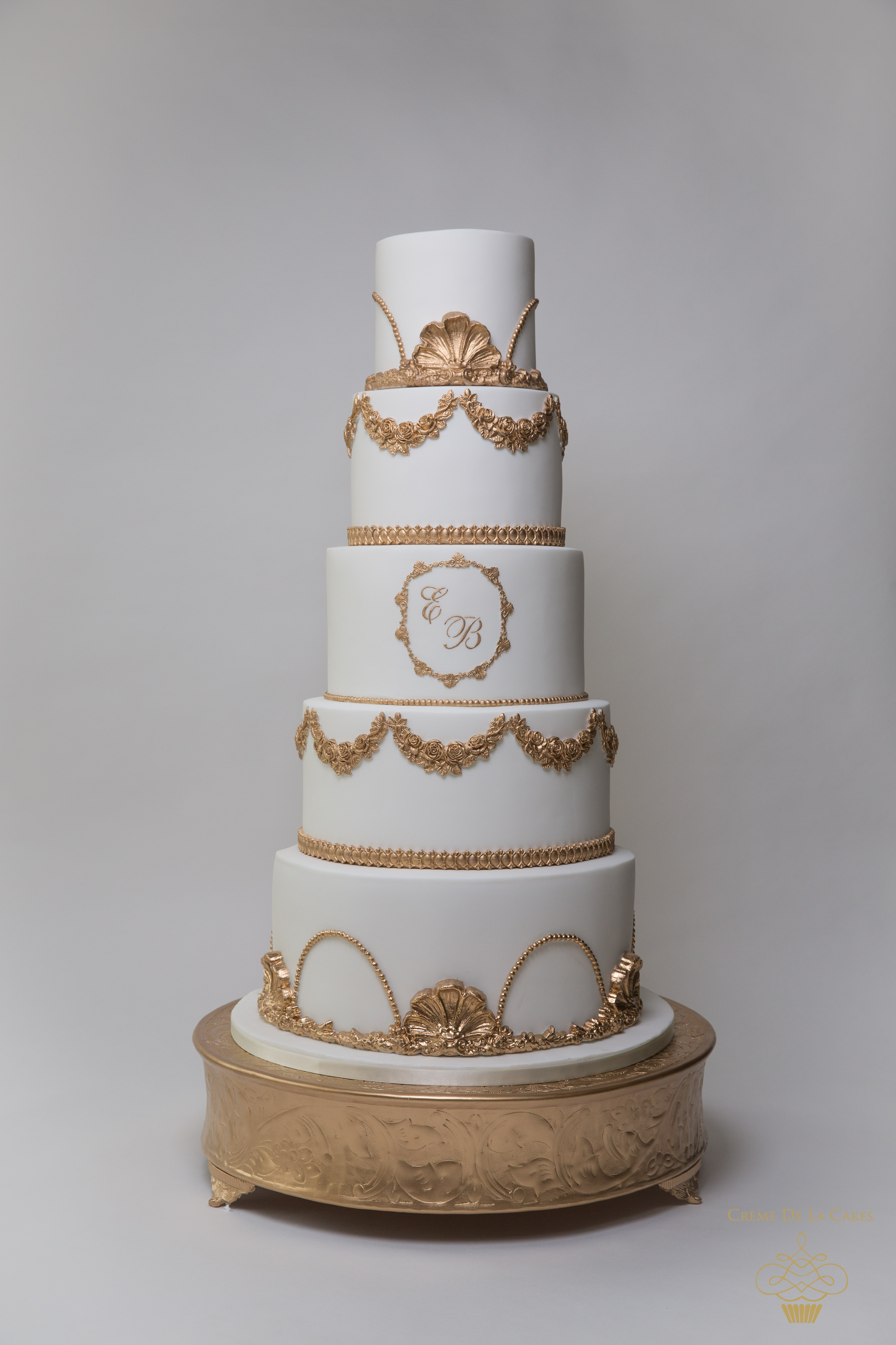 Gold Wedding Cakes  Sumptuous Regal Ivory and Gold Wedding Cake