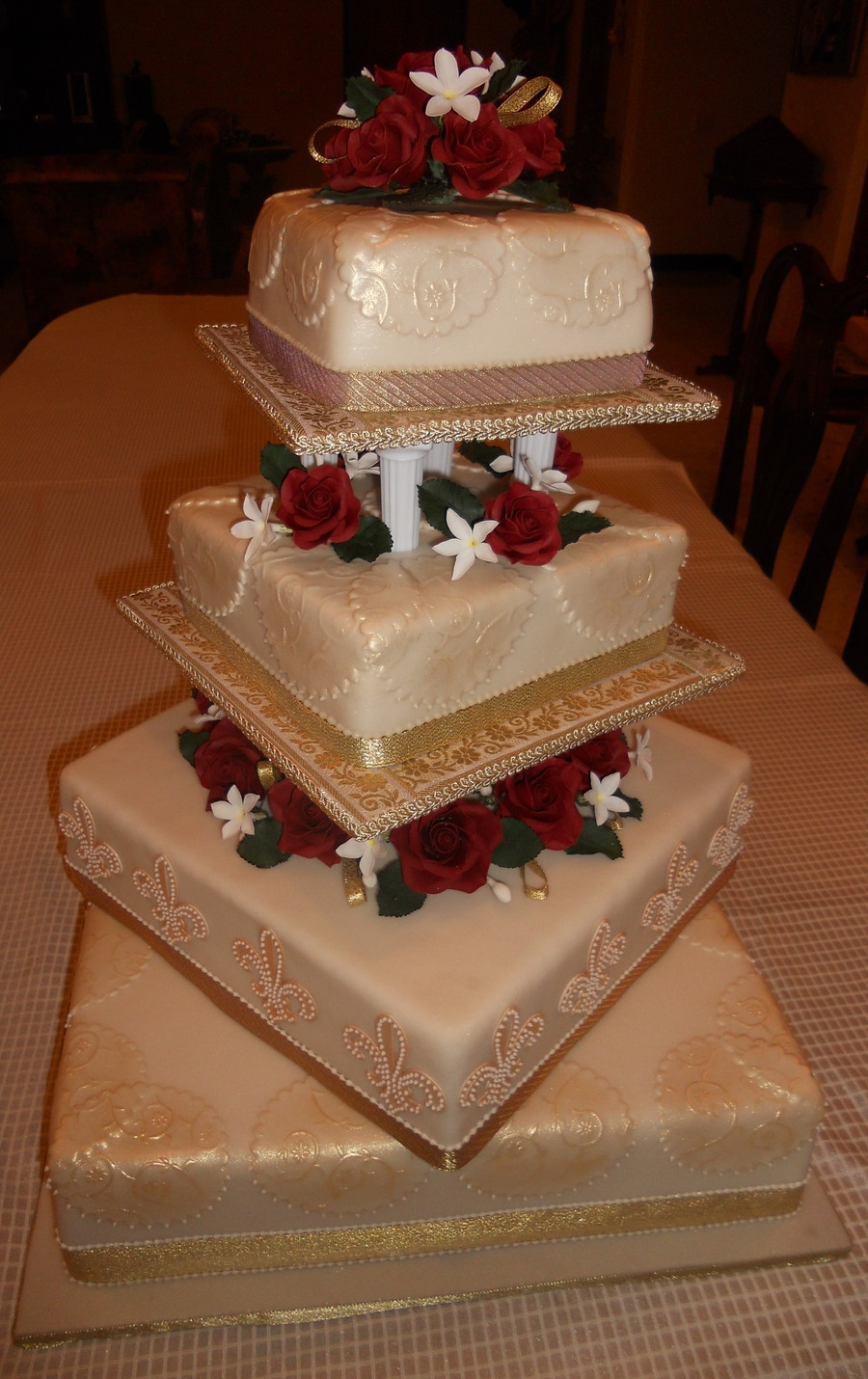 Gold Wedding Cakes  4 Tier Burgundy Cream & Gold Wedding Cake CakeCentral