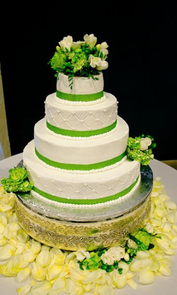 Green And White Wedding Cake  Four tier round white wedding cake with green bands and