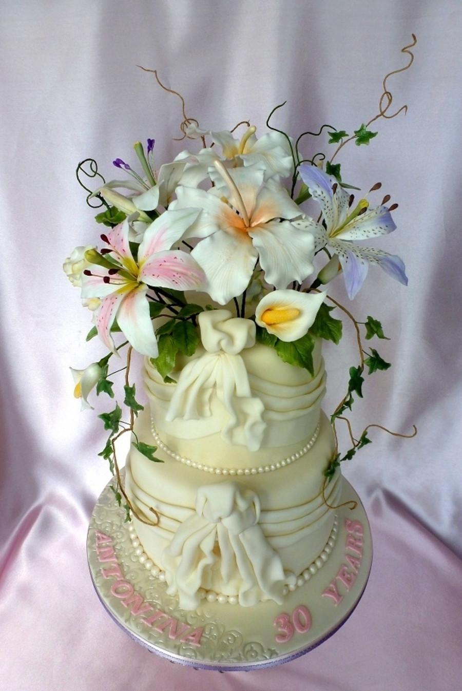 Gumpaste Flowers For Wedding Cakes  White Wedding Cake With Drapes And Gumpaste Flowers