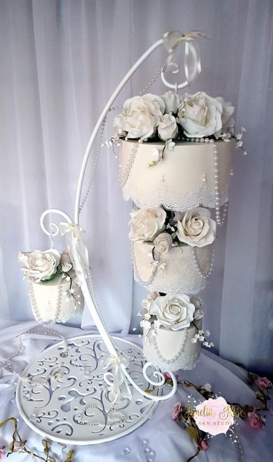 Hanging Wedding Cakes  Simplicity hanging chandelier cake cake by Amelia Rose