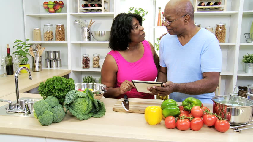 Healthy African American Recipes  Mature Ethnic Married Couple Holding Wireless Tablet