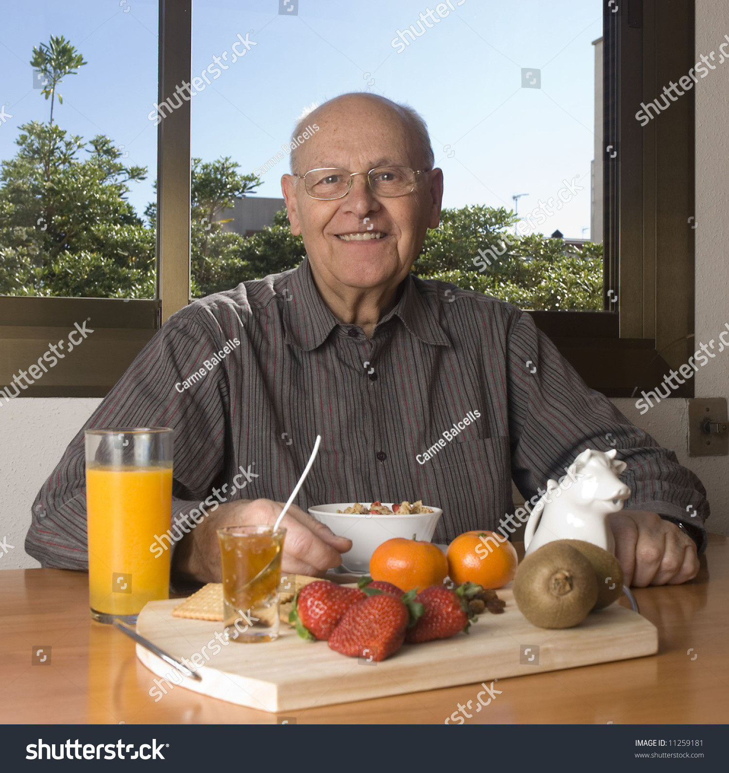 Healthy Breakfast At Home  Senior Man Having A Healthy Breakfast At Home Stock
