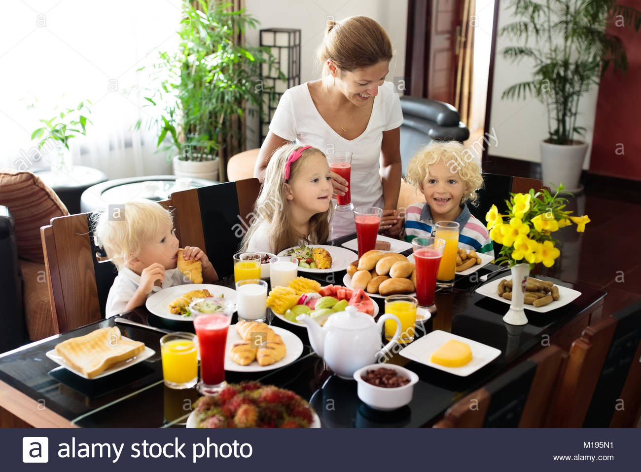 Healthy Breakfast At Home  Healthy family breakfast at home Mother and kids eating