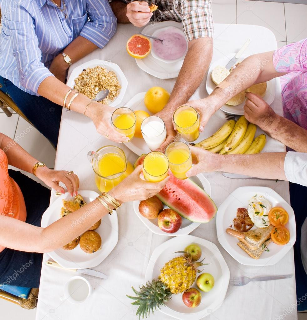 Healthy Breakfast For Group  Overhead view of group of having breakfast — Stock