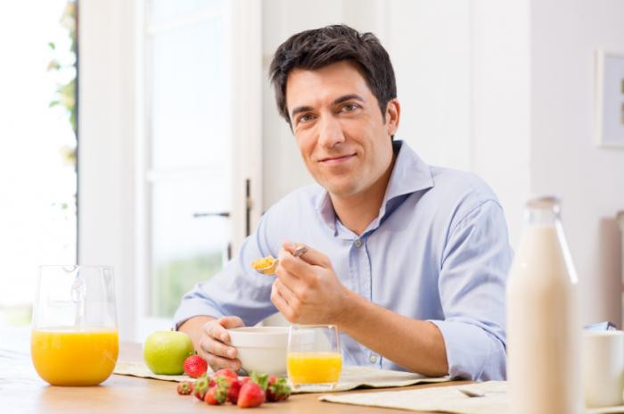 Healthy Breakfast For Men  Man eating breakfast