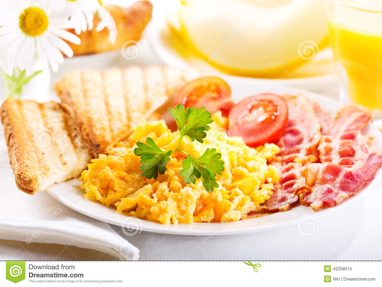 Healthy Breakfast Scramble  Breakfast With Scrambled Eggs Juice And Fruits Stock