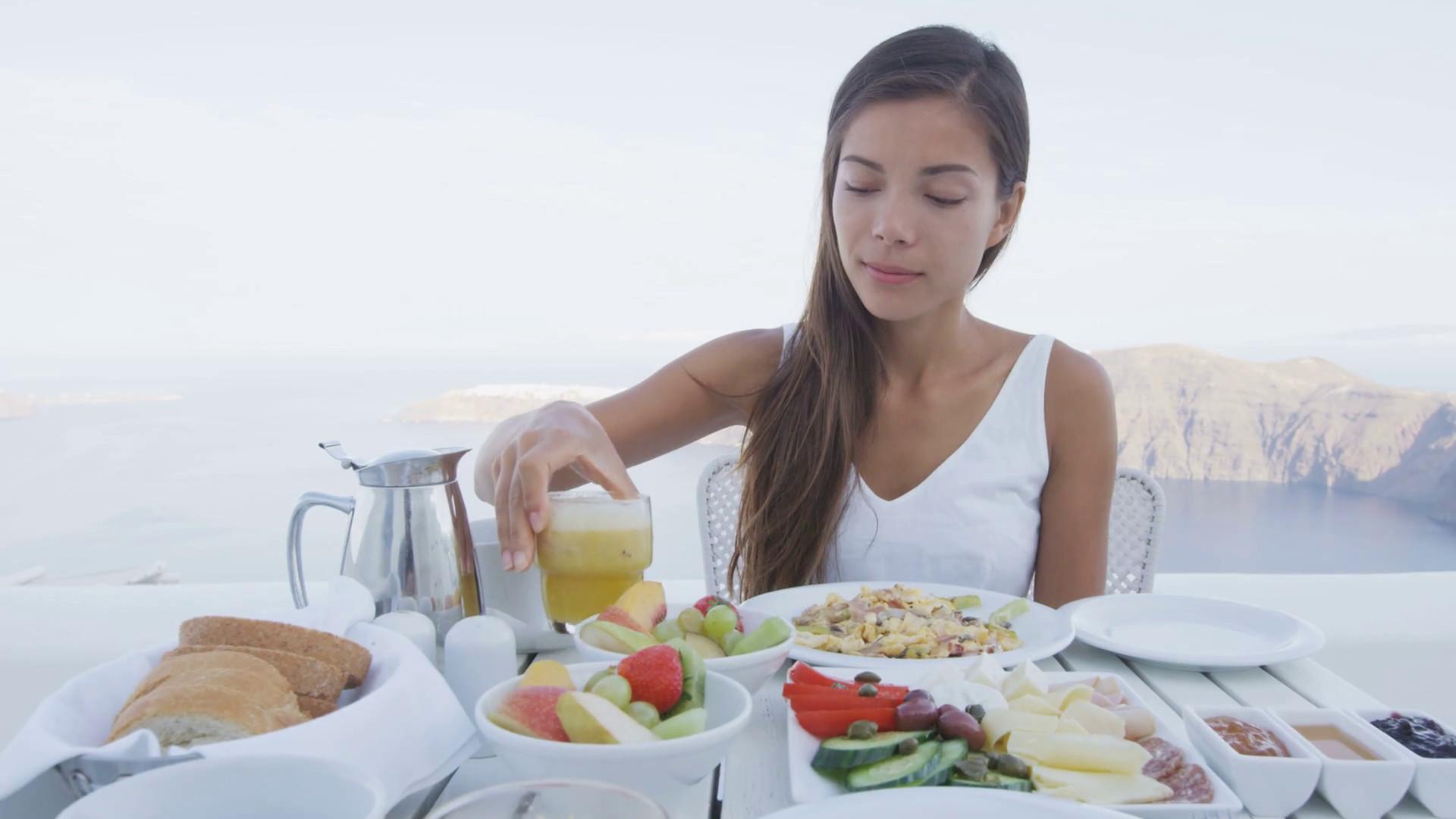 Healthy Eating Breakfast  Asian woman eating breakfast Female tourist having glass