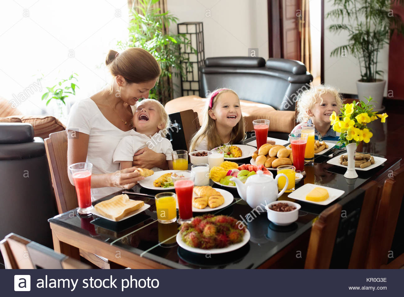 Healthy Family Breakfast  Healthy family breakfast at home Mother and kids eating