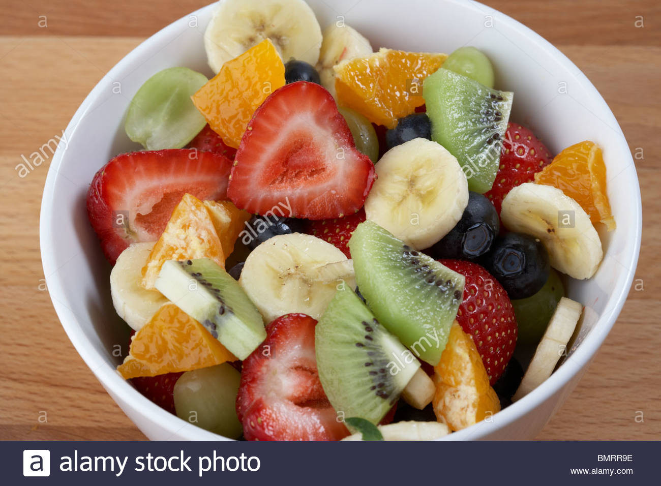 Healthy Fruit Breakfast  bowl of mixed fruit salad for a healthy breakfast Stock