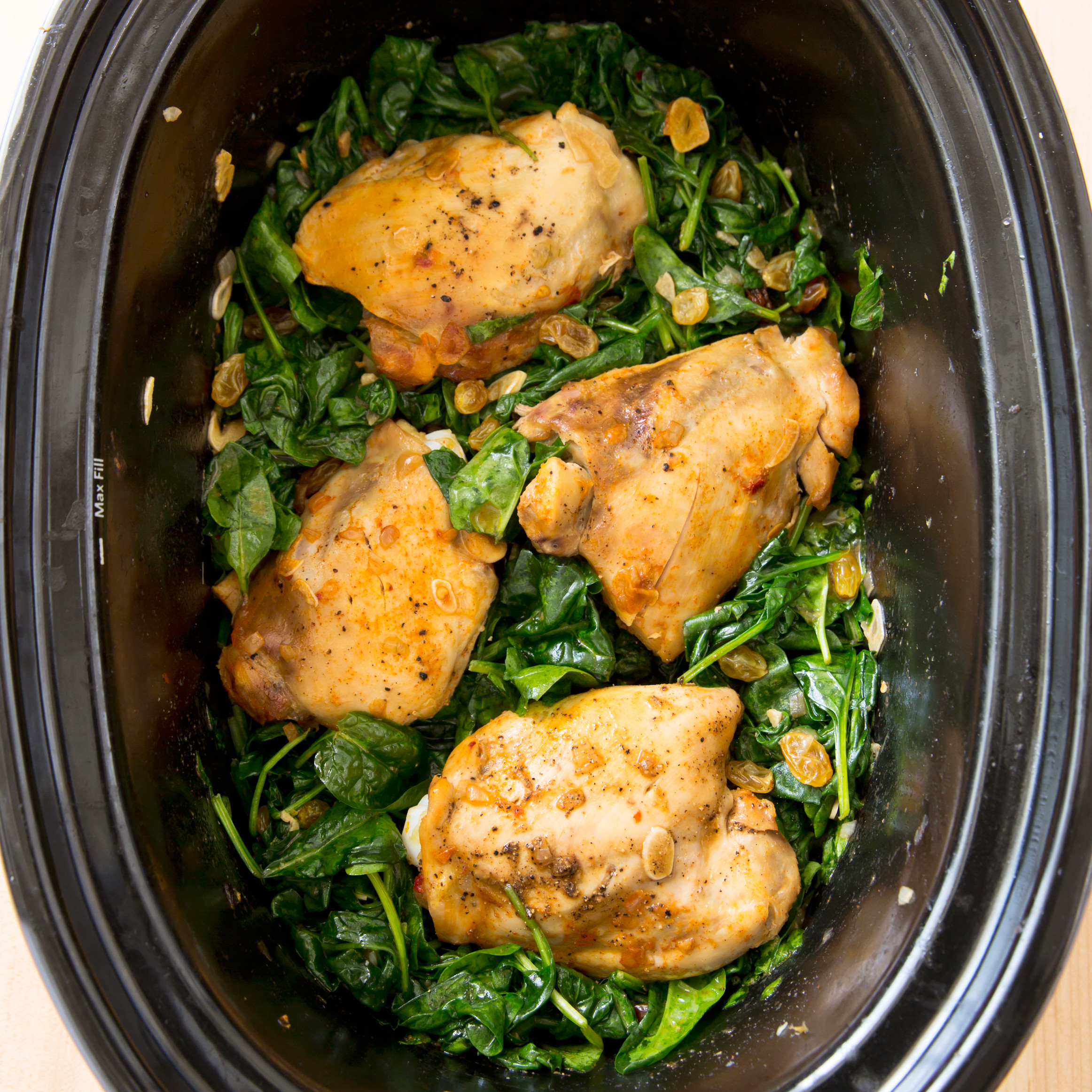 Healthy Slow Cooker Chicken Thighs  Slow Cooker Braised Chicken Thighs with Garlicky Spinach