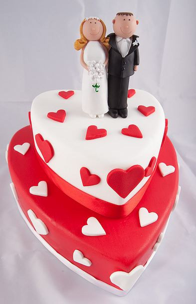 Heart Shape Wedding Cakes  Two tier heart shaped wedding cake in white and red with