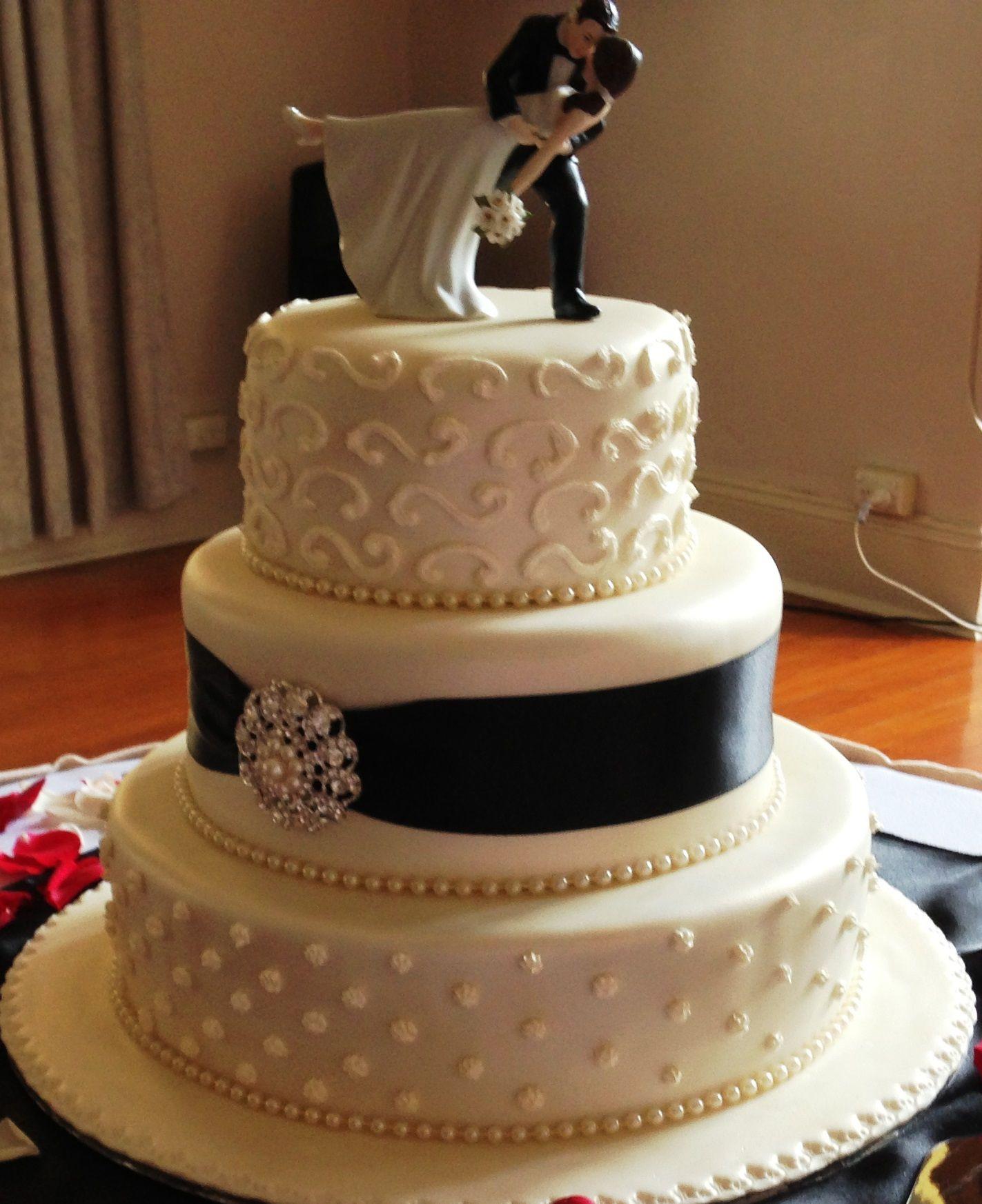 Heritage Wedding Cakes  3 tier round wedding cake black and white Destination