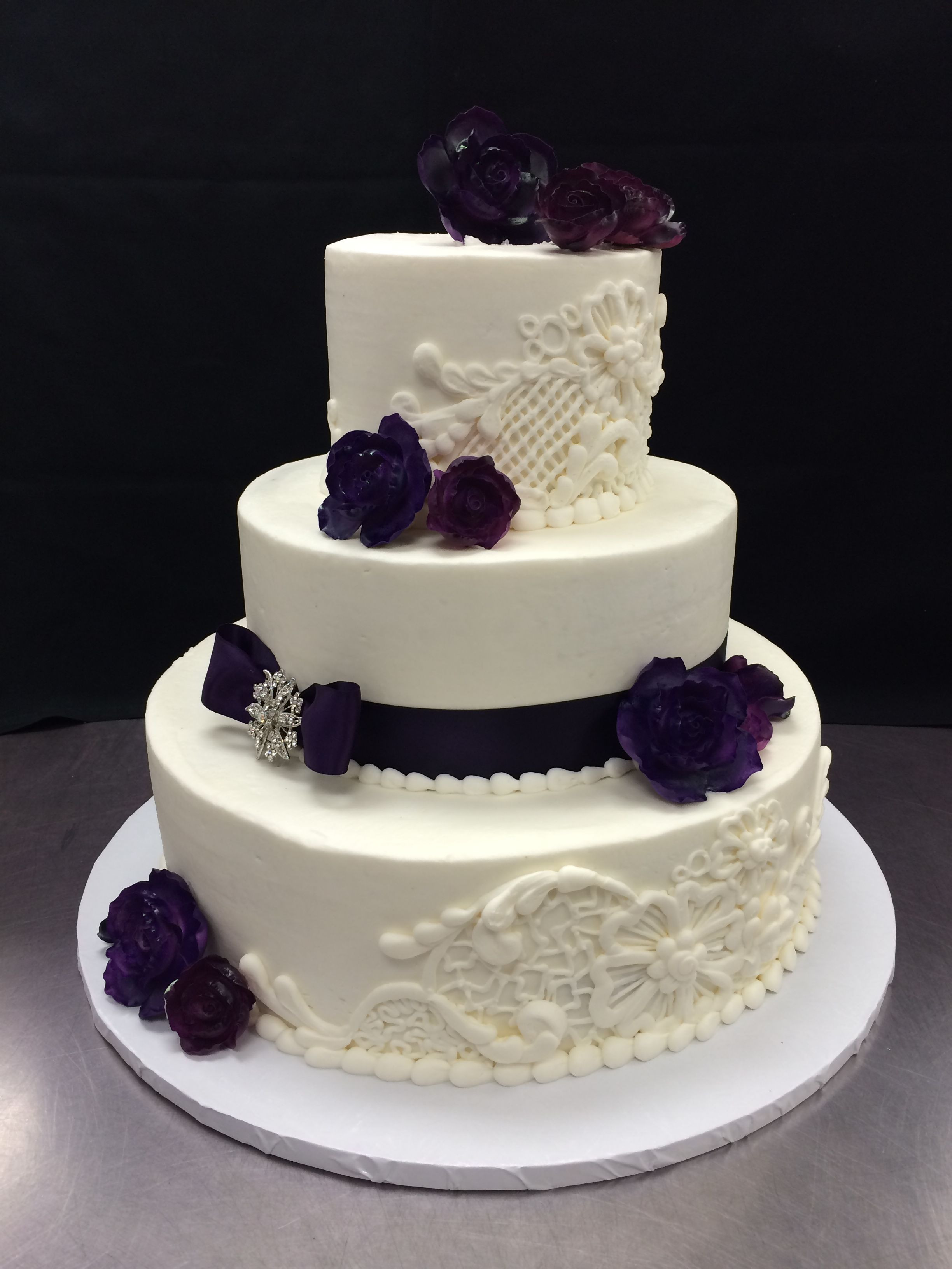 Hy Vee Wedding Cakes  Hand piped lace details and Gumpaste Purple Roses Cake by