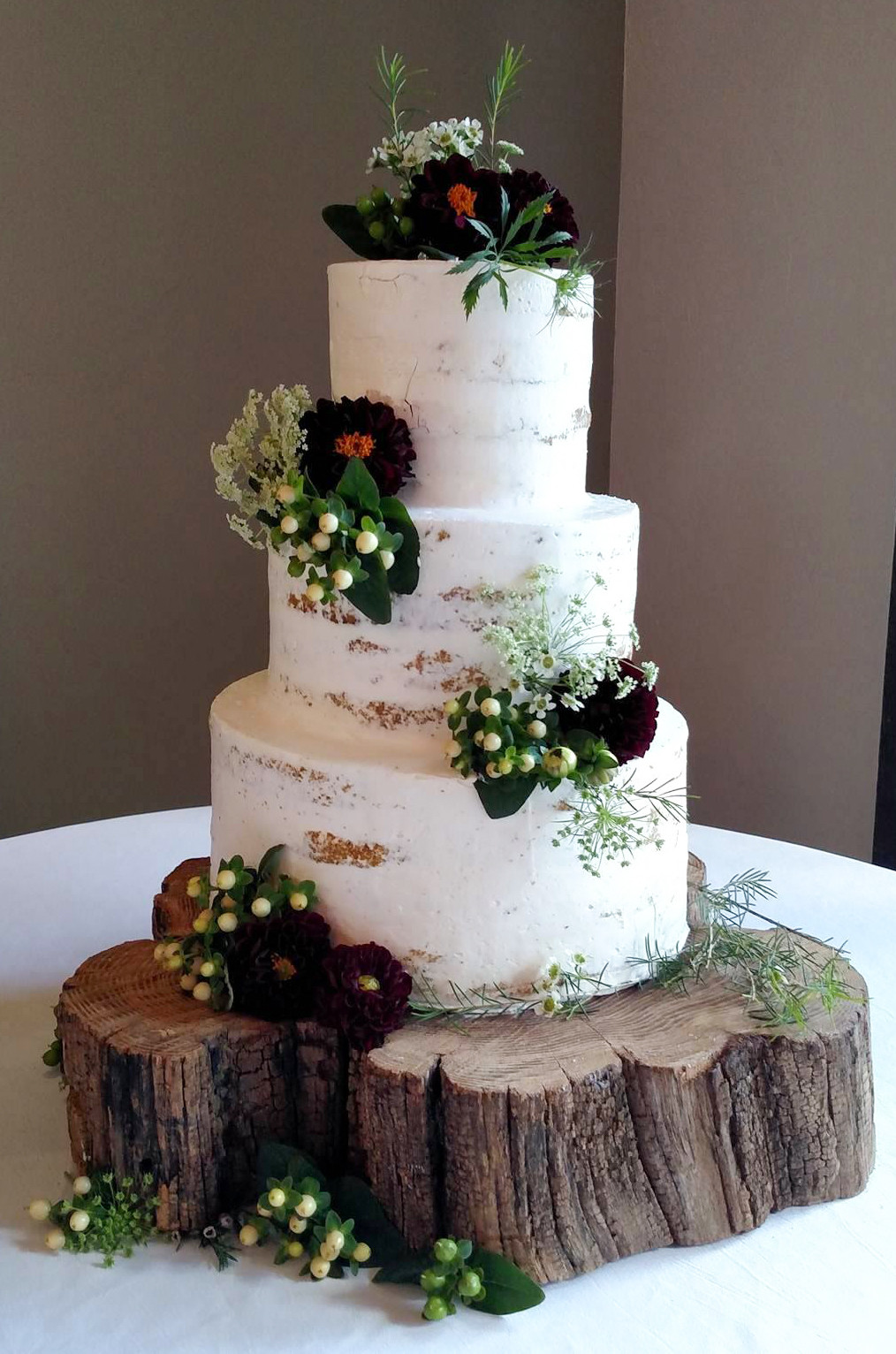 Iced Wedding Cakes  Barely iced cake with fresh flowers • Just Simply