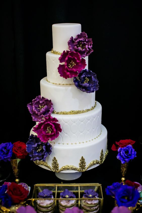 Jewel Wedding Cakes  White and gold wedding cake with Jewel toned sugar flowers